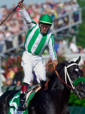 From May 4, 2002, jockey Victor Espinoza celebrates after riding War Emblem to victory in the 128th Kentucky Derby horse race at Churchill Downs in Louisville, Ky. War Emblem, the 2002 Kentucky Derby and Preakness winner, died Wednesday, March 11, 2020, at age 21.