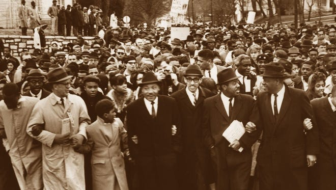 Vanguard of the civil -rights marchers included , from left, the Rev. Olof Anderson, Louisville; 13-year old Sherman McAlpin, Louisville; Dr. Martin Luther King; the Rev. Wyatt Walker, executive-secretary of the southern Christian Leadership Conference; the Rev. Ralph Abernathy, Dr. D. E. King, and Frank Stanley, Jr. Former baseball player Jackie Robinson is behind Abernathy and to right.