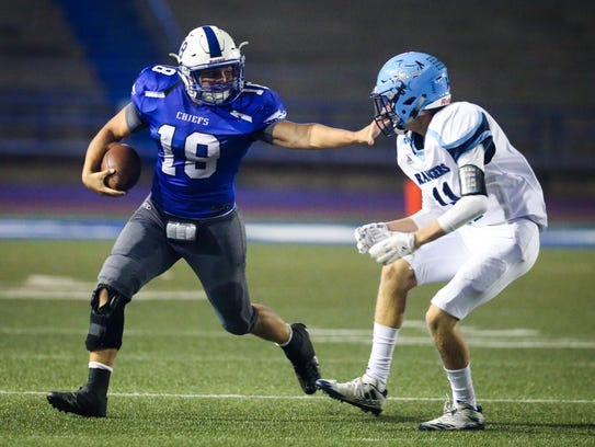 Lake View's Henry Nickias runs the ball against Greenwood