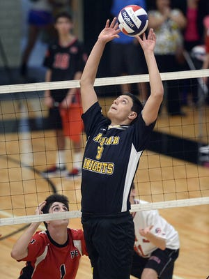 McQuaid's Charlie Siragusa reaches to set the ball during regular season game played at McQuaid Jesuit High School on Tuesday, September 15, 2015. McQuaid beat Penfield in four games (24-26, 25-23, 25-16, 25-16).