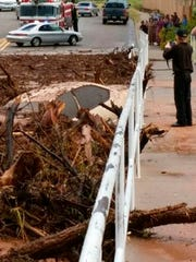 A vehicle rests in debris after a flash flood Monday,