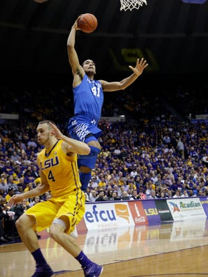 Kentucky forward Trey Lyles (41) goes to the basket 0ver LSU guard Keith Hornsby (4) in the first half of an NCAA college basketball game in Baton Rouge, La., Tuesday, Feb. 10, 2015.  Kentucky won 71-69. (AP Photo/Gerald Herbert)