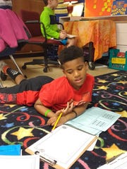 Demont Brown working on math in Sarah Bowling's second-grade class.