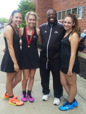 Springfield advanced girls singles player Kaylee Pigott and doubles team Laura Worley and Erica Dean to the Region 5-AAA tournament. From left, are Worley, Pigott, coach Curtis Holland and Dean.