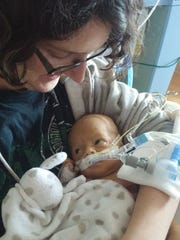 Jenn Zillins holding her son Frank for the first time