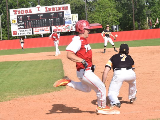 Tioga's Corbin Malone (9, left) hit a grand slam against Pearl River last weekend in the playoffs. The Indians will host Westgate in the Class 4A quarterfinals this weekend.
