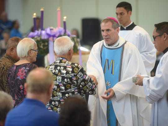 War surivors deliver the offertory to Coadjutor Archbishop Michael Jude Byrnes during a Mass in honor of Guam's World War II survivors at the Dulce Nombre de Maria Cathedral-Basilica in Hagåtña on Dec. 8, 2016.  The Mass was organized by the Guam War Survivors Memorial Foundation and the Archdiocese of Agana.