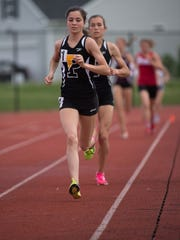 Padua's Lydia Olivere leads the Division I girls 1600-meter run at the DIAA State Track & Field Championships at Dover High School.