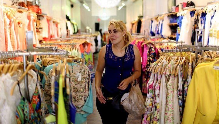Gaby Lopez shops for clothes at the Steps New York store on April 14, 2015, in Miami.