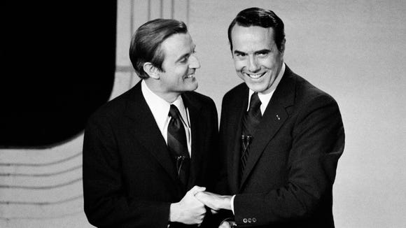 Walter Mondale and Bob Dole shake hands before their
