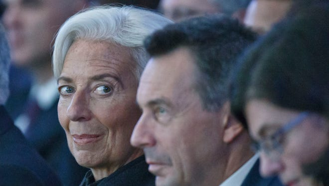 Managing Director of the International Monetary Fund Christine Lagarde, left, attends the plenary session of the World Economic Forum in Davos, Switzerland, Wednesday, Jan. 20, 2016.