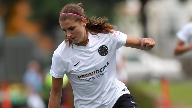 In a game July 21, 2013, Portland Thorns FC forward Alex Morgan (13) dribbles the ball against the Boston Breakers during the first half at Dilboy Stadium.