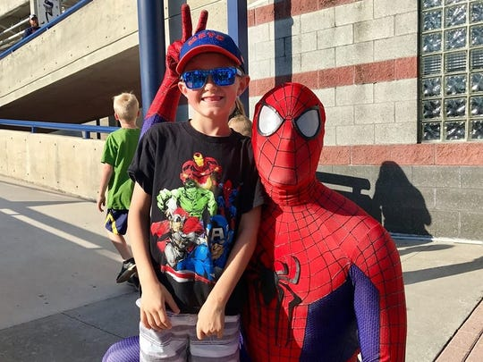 """""""Spidey"""" poses with a happy fan at the 2018 """"Be a Hero"""" night at First Data Field in Port St. Lucie."""