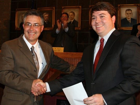 File photo from 2011 shows Mayor Gillespie and then-City Prosecutor Rob Riddle. Gillespie appointed local attorney Rob Riddle as interimcity attorney this week.