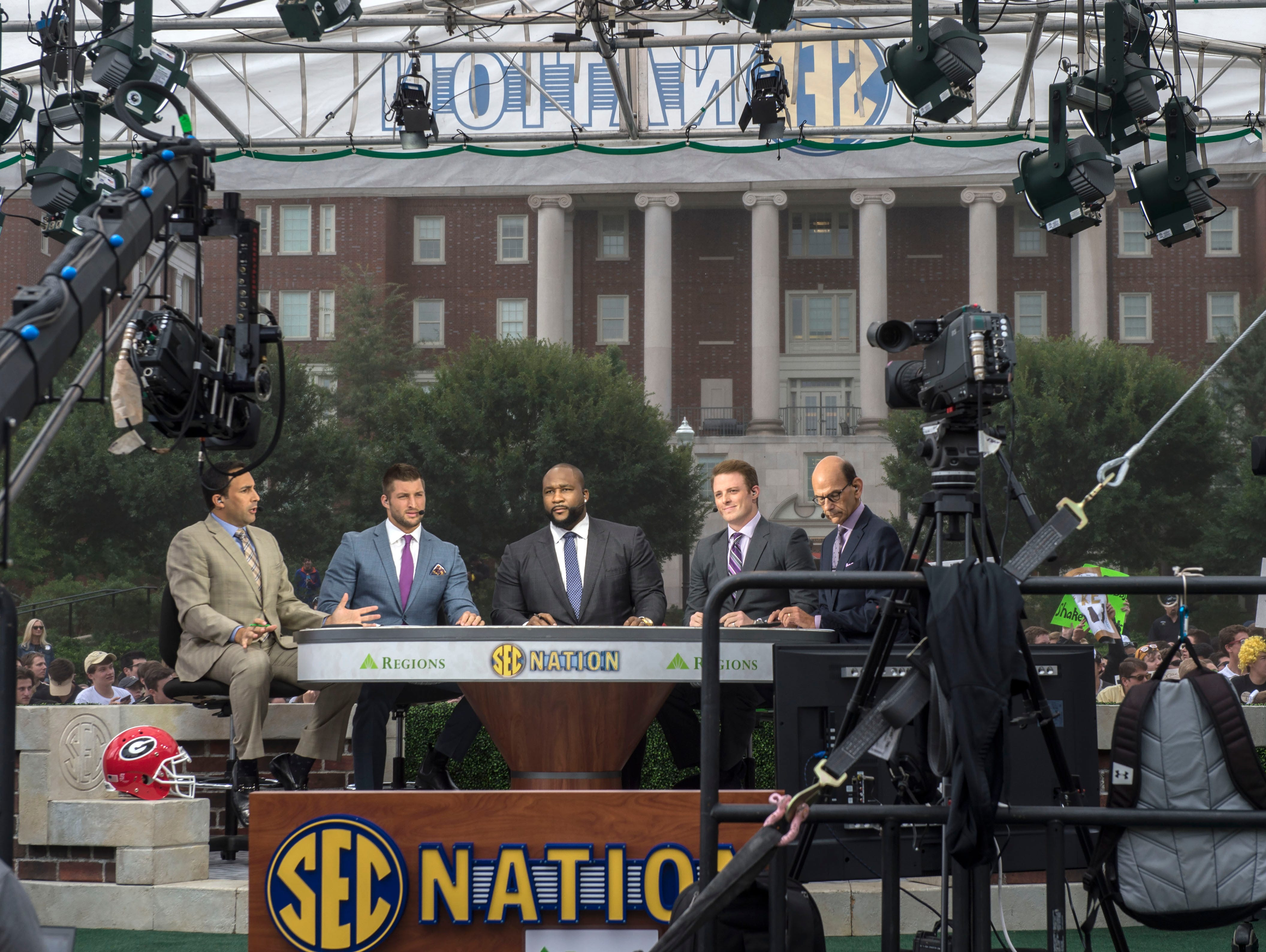 "Tim Tebow, second from left, returned to his role as an analyst on ""SEC Nation,"" the SEC Network's traveling pregame show, which aired live from The Commons on Vanderbilt's campus. Tebow was joined by Joe Tessitore, Marcus Spears, Greg McElroy and Paul Finebaum and Kaylee Hartung on Saturday, Sept. 12, 2015."