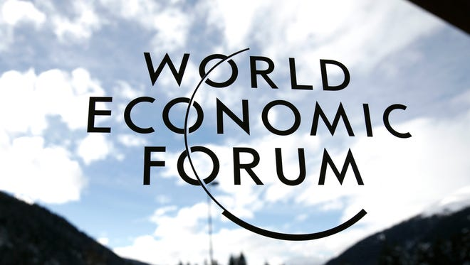The World Economic Forum's (WEF) logo is displayed on a window inside the Congress Center ahead of the meeting in Davos, Switzerland.