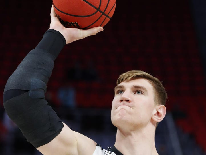 Purdue's Isaac Haas shows the brace on his fractured