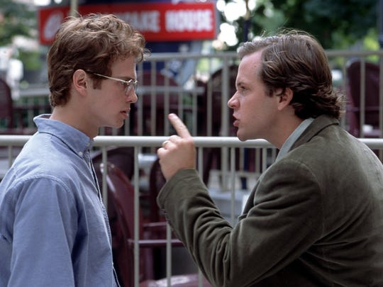 "Editor Chuck Lane (Peter Sarsgaard, right) confronts Stephen Glass (Hayden Christensen) in 2003's ""Shattered Glass."""