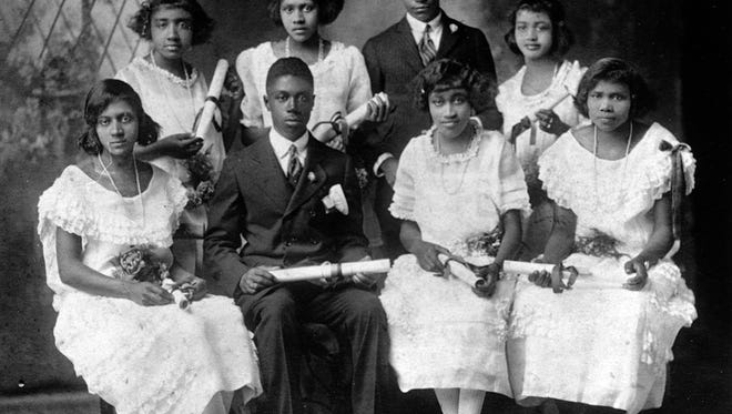 The 1924 11th grade class at Bradley Academy. Standing from left to right, Richinell King, Nevada Crenshaw, Calvin Johnson, Geneva Buford; Seated from left to right, Fruzzie Burrus, George Francis, Lillian Murray, Marie Bright.