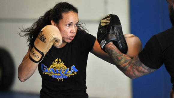 UFC fighter Marion Reneau trains with coach Doug Marshall at Elite Team Visalia.