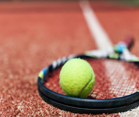 A stock image of a tennis ball and racquet.