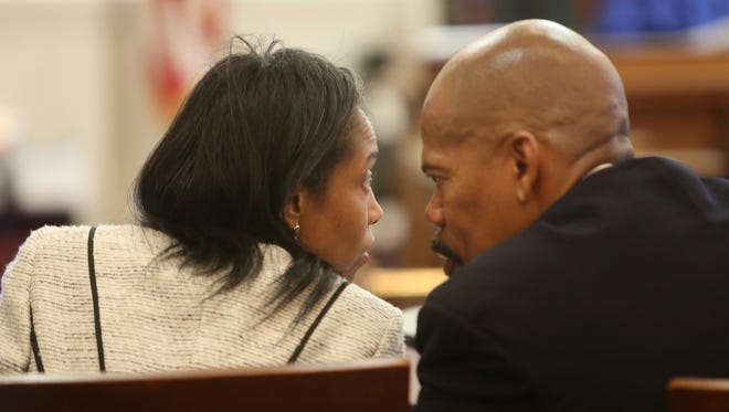 Judge Tracie Hunter talks with her lawyer Clyde Bennett II during Opening Statements in the corruption trial against Hunter at the Hamilton County Courthouse on Wednesday, September 10, 2014.