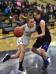 Manogue's Kenna Holt drives against McQueen's Izzy