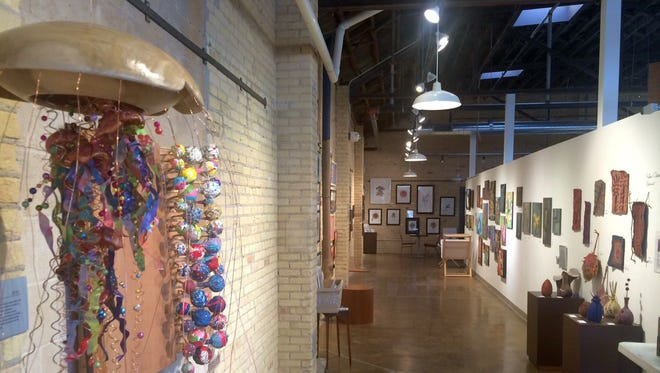 Gallery exhibits inside The ARTgarage in Green Bay on Wednesday, March 2, 2016.