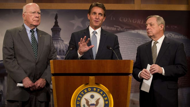 A group of senators including, from left,  Patrick Leahy, D-Vt.,  Jeff Flake, R-Ariz., and  Dick Durbin, D-Ill., have filed a bill to end the 50-year-old trade embargo with Cuba.