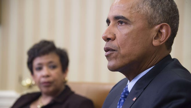 President Obama speaks with Attorney General Loretta Lynch in the Oval Office Monday. Obama is poised to unveil a raft of executive actions to tackle gun violence, kicking-off his last year in the White House with a show of political power.