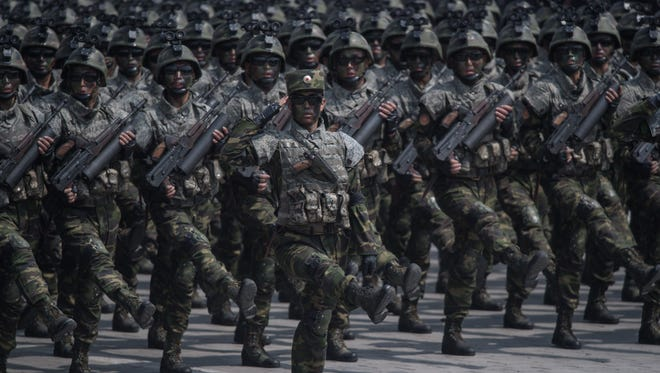 Korean People's Army (KPA) soldiers march through Kim Il-Sung square during a military parade marking the 105th anniversary of the birth of late North Korean leader Kim Il-Sung, in Pyongyang on April 15, 2017.   / AFP PHOTO / ED JONES        (Photo credit should read ED JONES/AFP/Getty Images)