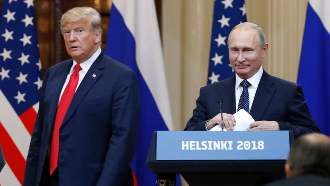 FILE - In this July 16, 2018, file photo, U.S. President Donald Trump, left, and Russian President Vladimir Putin arrive for a press conference after their meeting at the Presidential Palace in Helsinki, Finland.