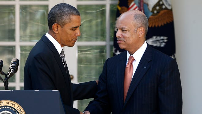 President Barack Obama shakes hands with Jeh Johnson, now the Homeland Security secretary, in the Rose Garden at the White House in Washington on Oct. 18, 2013.