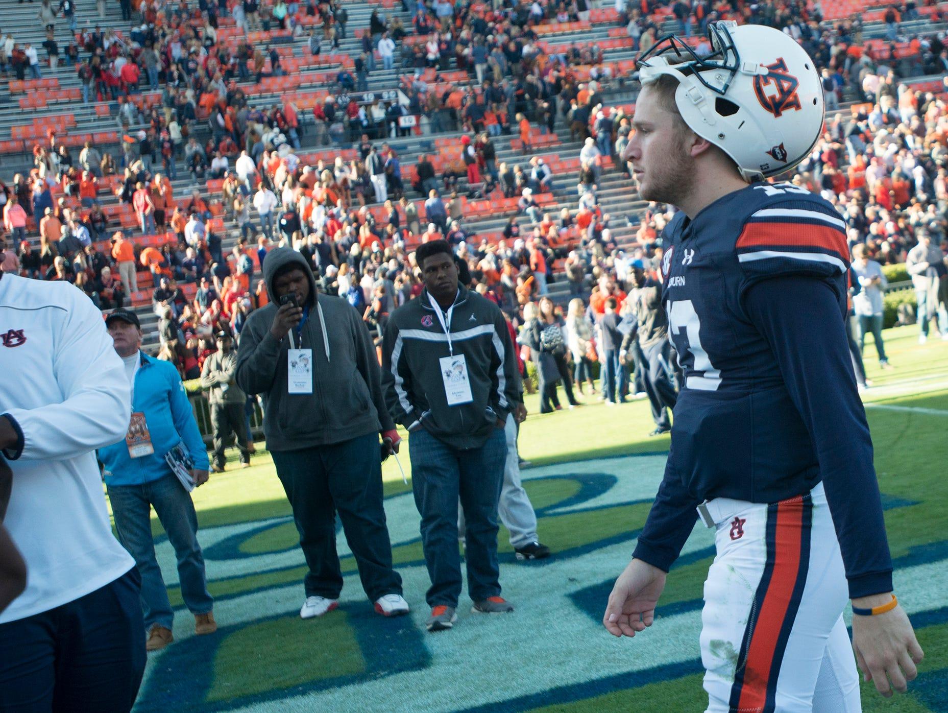 Auburn Tigers quarterback Sean White (13) walks off the field after the NCAA football game between Auburn Tigers and Georgia on Saturday, Nov. 14, 2015, in Auburn, Ala. Georgia defeated Auburn Tigers 20-13.