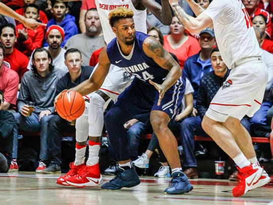 Nevada's Jordan Caroline has diversified his game, but his roots are still playing in the post.