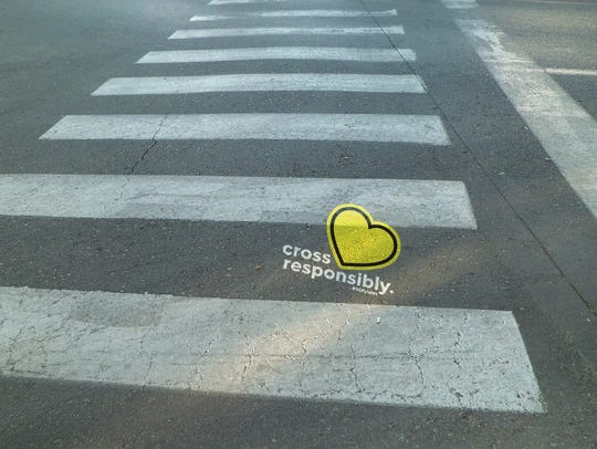 A photo illustration showing what crosswalk decals