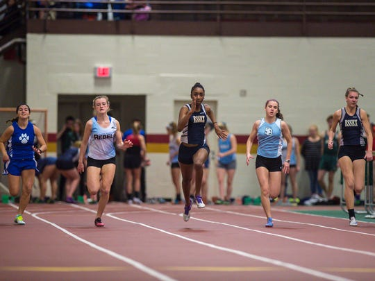 Essex's Sade Hankey, center, leads the way in the 55-meter dash during the high school indoor track and field state championships in Northfield on Saturday, February 4, 2017.