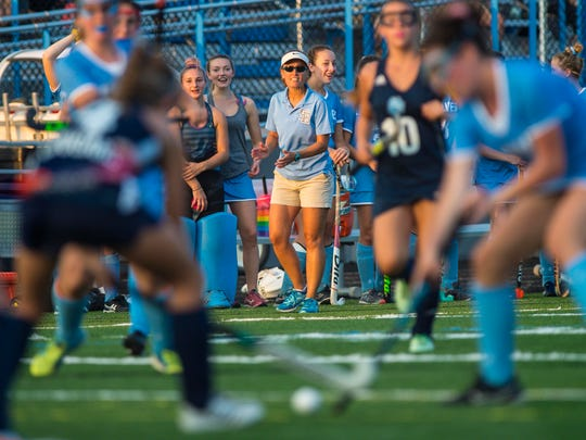 South Burlington field hockey coach Anjie Soucy urges on her players during their match against Mt. Mansfield in South Burlington on Wednesday, September 27, 2017.