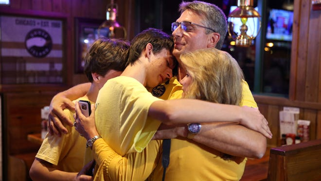 Mark Earley celebrates his win for Leon County Supervisor of Elections with his two sons Preston, 16, Braden, 13, and his Fiance Stacey Rodriguez at Miller's Ale House on Election Day Tuesday, Nov. 8, 2016.