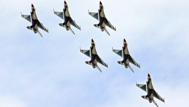 """The Flying F-16C Fighting Falcon Thunderbirds perform at the Milwaukee Air & Water Show in 2015.  """"To have a group like the Air Force Thunderbirds come, you have to have done numerous items so the partnership to pull off an air show like that is enormous,"""" 179th Wing Commander Colonel Allison Miller told Richland County commissioners regarding efforts to bring a major air show to Lahm Airport in a few years."""