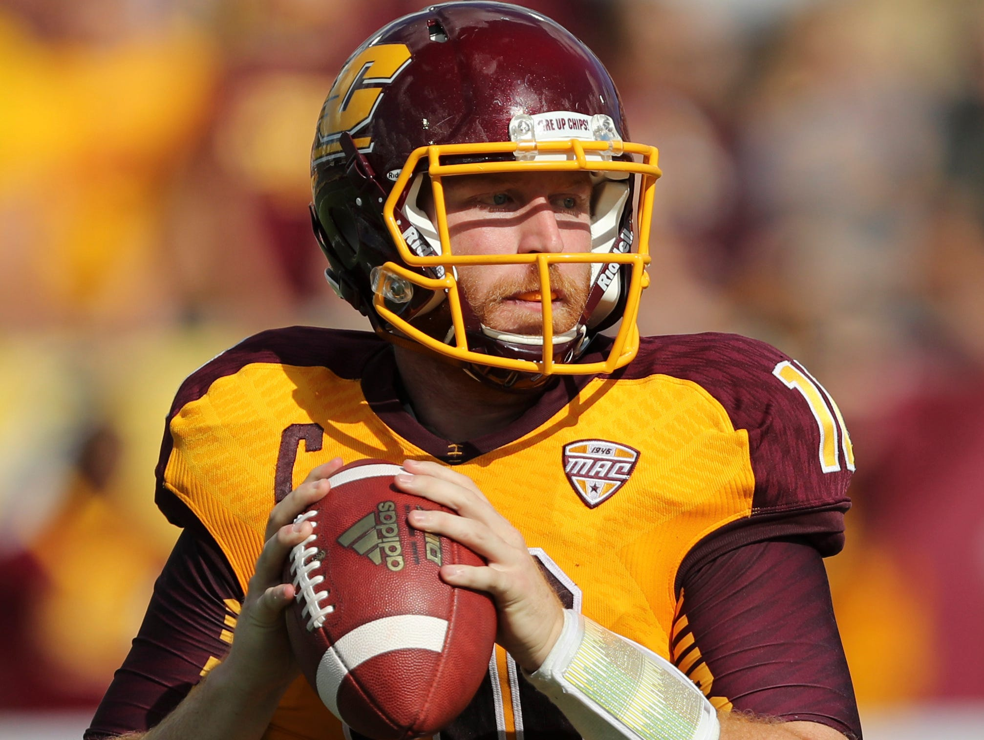 CMU senior and Lansing Catholic graduate Cooper Rush is a finalist for the William V. Campbell Trophy.