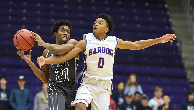FRA's Kenny Cooper (21) is fouled by Harding Academy's Calvin Austin (0) during the TSSAA DII-A boys basketball championship game at Lipscomb University on Saturday, March 5, 2016.