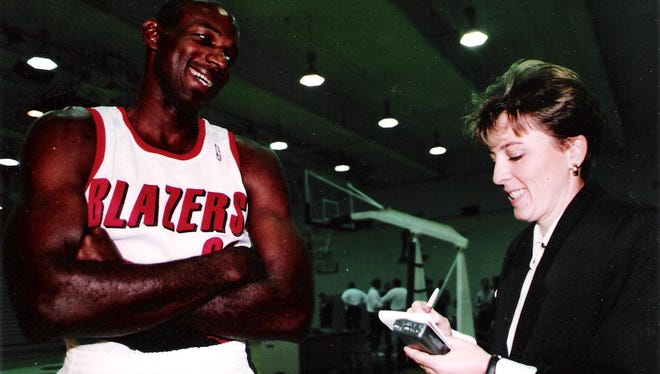 Statesman Journal sports reporter Capi Lynn interviews Clyde Drexler. .