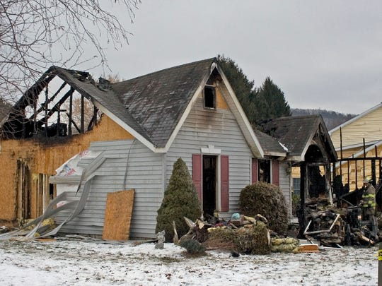 A woman was found dead after a fire early Tuesday that