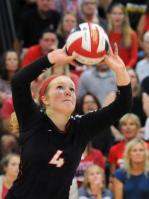 Wauwatosa East setter Tara O'Donnell sets the ball