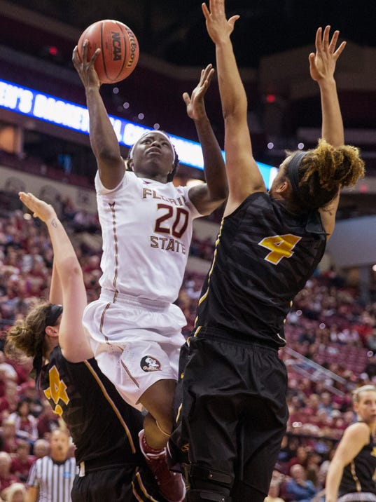 Florida State forward Shakayla Thomas shoots between Missouri's Sierra Michaelis, left, and Cierra Porter during the second half of a second-round game of the NCAA women's college basketball tournament in Tallahassee, Fla., Sunday, March 19, 2017. Florida State defeated Missouri 77-55. (AP Photo/Mark Wallheiser)