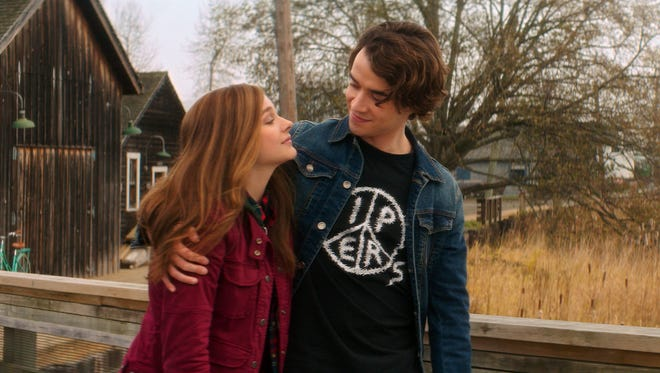Mia (Chloe Grace Moretz), left and Adam (Jamie Blackley) grapple with young love amidst tragedy in 'If I Stay.'