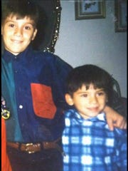 Nathaniel Gutierrez, 9, (left) hugs his 5-year-old brother Jeremy Flores. Gutierrez's 2014 killing remains one of the city's unsolved homicide cases.