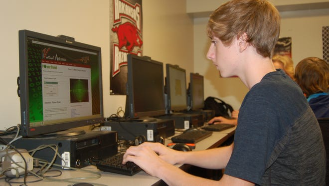 Alex Burns, a 15-year-old sophomore at Mountain Home High School, works on the English preparation portion of the American College Testing (ACT). Some colleges award scholarships to students based on their performance on the ACT.