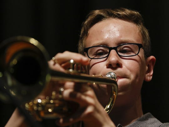 Cole Sprang, eighth grade, solos on the trumpet during